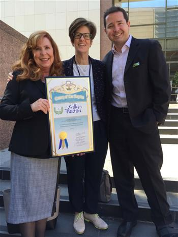 Award winner Sally Patchen, LACBA Civic Mediation Project volunteer, shows off her County Award with Project Staff Julie Ware and Andrew Culberson